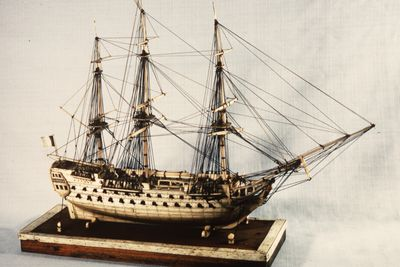 H5217 Ship model in case, 72 gun French Frigate warship, possibly representing the 74 gun 'Le Heros', bone / wood / perspex, made by a Napoleonic prisoner-of-war, c. 1800