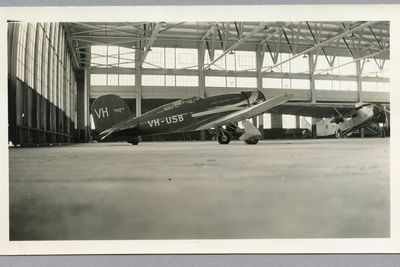 85/112-32 Photograph, black and white, Lady Southern Cross aircraft in hanger, paper, photographer unknown, Oakland, California, United States of America, 1934