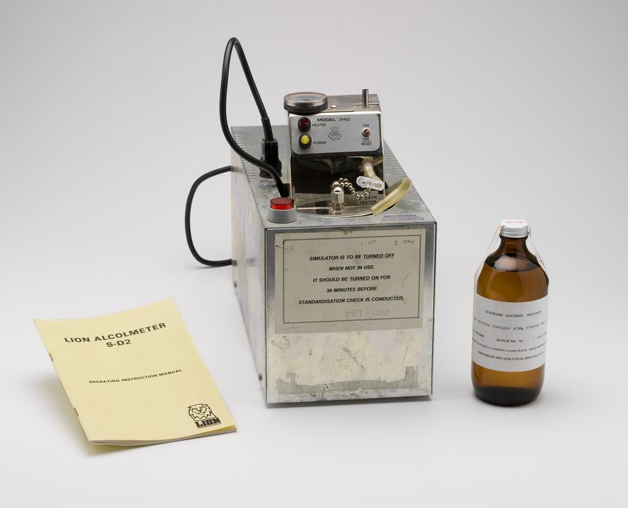2010/30/1 Gas simulator, manual and bottle of alcohol, used with blood alcohol testing, metal / glass / plastic / electronic components / paper, made by Guth Laboratories Inc, Harrisburg, Pennsylvania, United States of America and Bio Analytical Services, Australia, c. 1995, used by the New South Wa. Click to enlarge.