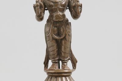 2003/136/16-1 Figure of Surya, from display, standing on lotus base, bronze, maker not recorded, South India or Orissa, 1500-1700