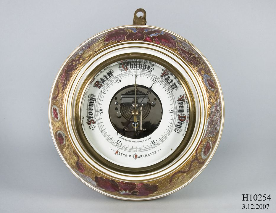 H10254 Aneroid barometer, metal / ceramic / glass, made by J H Steward Limited, Strand and Cornhill, London, England, 1885-1895. Click to enlarge.