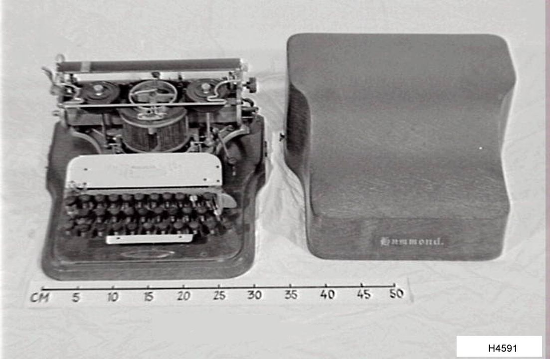 H4591 Typewriter, Hammond serial No 48037, with wooden cover, metal / wood / plastic, United States of America, c.1884. Click to enlarge.