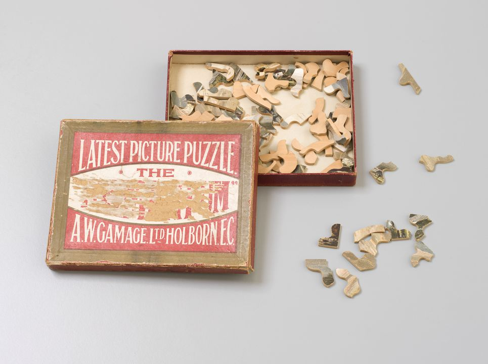 2012/35/4 Jig-saw puzzle with packaging, 'Tintern Abbey' No.1, timber / cardboard, made by A. W.Gamage Ltd, Holborn, London, England, 1898-1940, used by Mabel Walker (nee Mansfield), Wahroonga, New South Wales, Australia, c.1914. Click to enlarge.