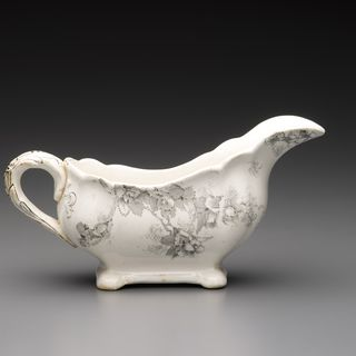 2001/2/21 Sauceboat, 'Manly Beach' pattern, Australian flora, transfer printed, earthenware, / glaze, Doulton and Co, Burslem, Staffordshire, England, distributed by Holdsworth, Macpherson & Co, Sydney, New South Wales, Australia, c. 1895