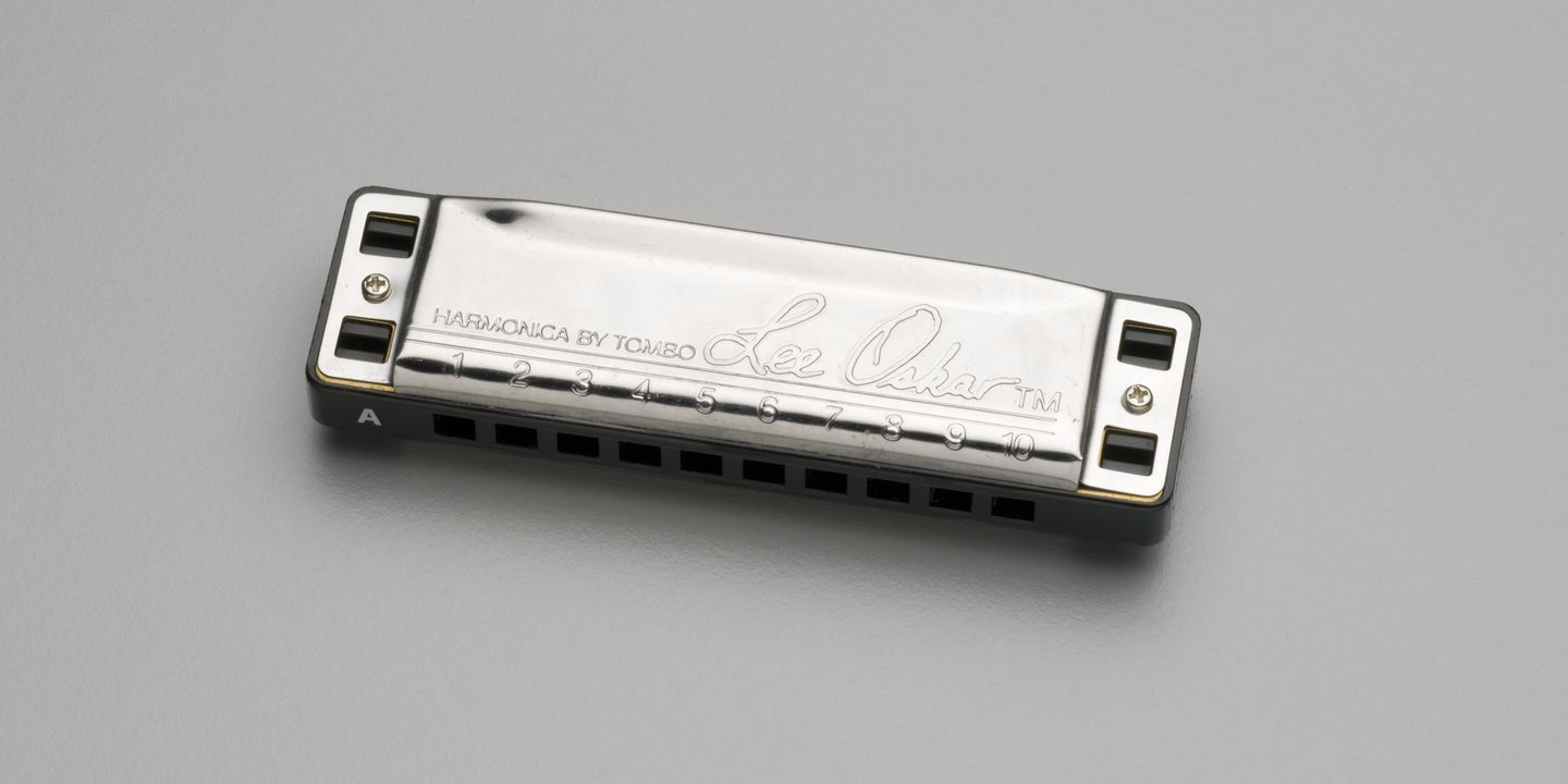 2007/216/1 Harmonica (mouth organ), 'Lee Oskar', stainless steel / brass / plastic, made by Tombo, Japan, used by Paul Kelly, Australia, 2000-2001. Click to enlarge.