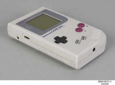 2003/167/1 Electronic toy, Nintendo 'Game Boy' handset, model DMG-01 and 'Tetris' game cartridge, made from plastic, rubber and electronic components, 'Game Boy' designed by Gunpei Yokoi, Tetris designed by Alexey Pajitnov, manufactured by Nintendo, Japan, 1984 / 1989
