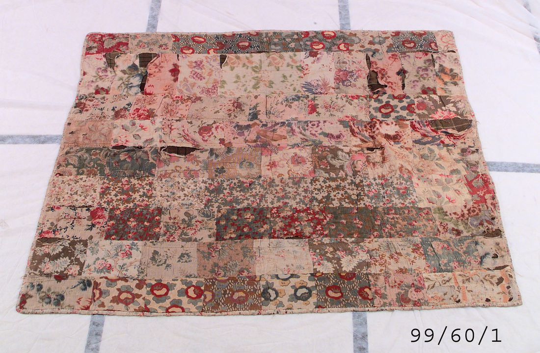 99/60/1 Quilt, 'Wagga' patchwork style, delicate floral motif, cretonne / cotton / wool, made by Mrs Sayers and finished by Norah McPhee-Hall, Muswellbrook / Glen Innes, New South Wales, Australia, 1910-1950. Click to enlarge.