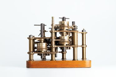 96/203/1 Calculating engine, specimen piece, with instructions and engraving, 'Difference Engine No1', bronze / steel / wood / paper, designed by Charles Babbage, parts made by Joseph Clements, assembled by Henry Provost Babbage, England, 1822-1879