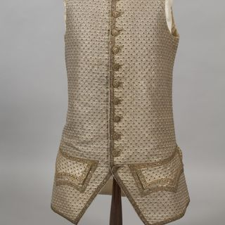 A8705 Waistcoat, mens, silver tissue woven with tiny strawberry-like motifs / spangles / gold metallic thread, maker unknown, [England or France, c. 1770]