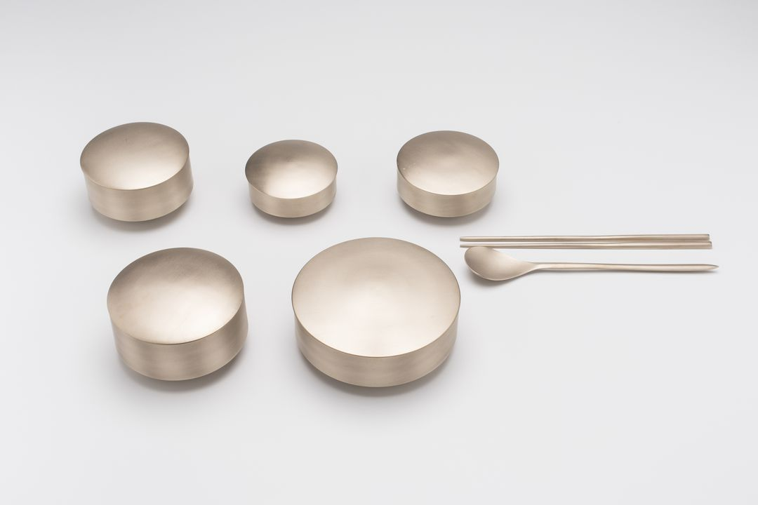 2017/60/1 Tableware, 'Bareum' set of five bowls with lids, 'Binyeo' set of chopsticks and spoon, brass, designed by GIO Kisang, made by GIO Kisang and KIM Soo-Young, Korea, 2013-2017. Click to enlarge.