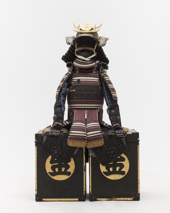 H4934 Suit of armour and horse tack (47 pieces), textile / leather / wood / lacquer / metal / paper, insignia of samurai officer [Koma Kaemon] of Bizen clan, Edo period, Japan, [1775]. Click to enlarge.