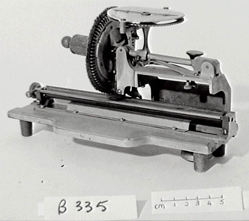B335 Columbia Typewriter. - 1884 Wheel machine - has advantage of variable spacing, and wheels having different styles can be interchanged, but is not capable of the rapidity of type bar machines (LC).. Click to enlarge.