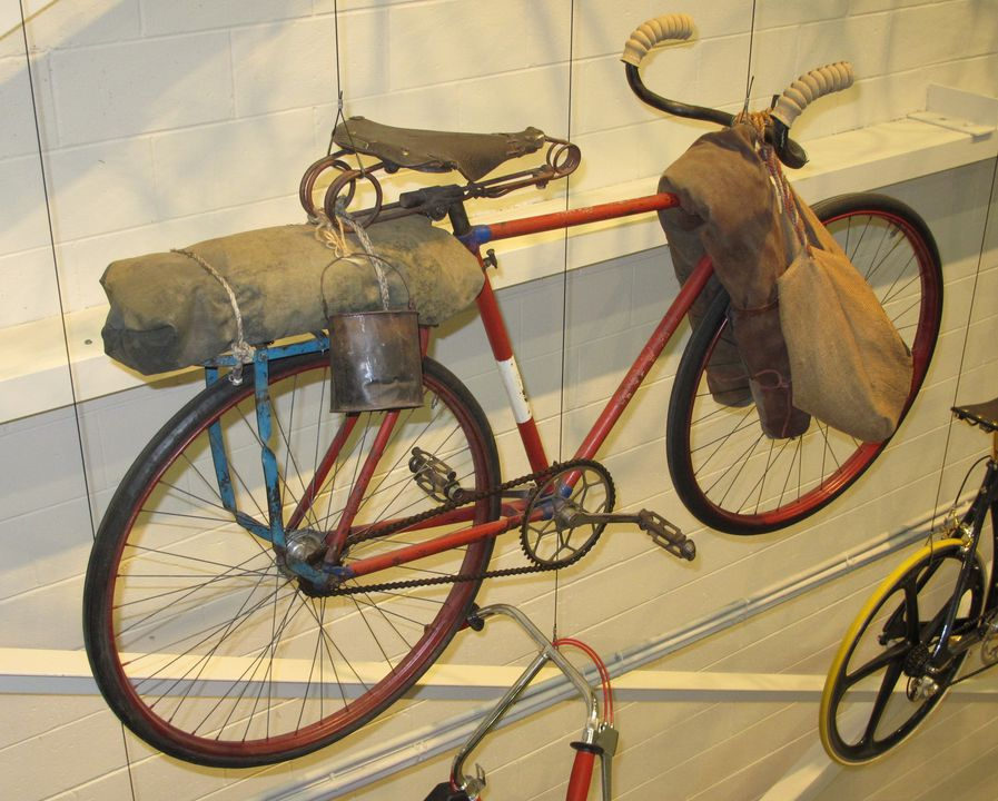 2009/9/1 Bicycle, 'Royal', safety type, fitted out as a shearer's bicycle with a swag, billy, tucker bag and canvas roll, metal / hessian / leather / canvas, maker unknown, [used in Australia], 1910-1940. Click to enlarge.