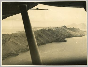 85/112-47 Photograph, black and white, Mangareva as seen from the air by the crew of Frigate Bird II, paper, photograph by H Purvis, Mangareva, Gambier Islands, 1951