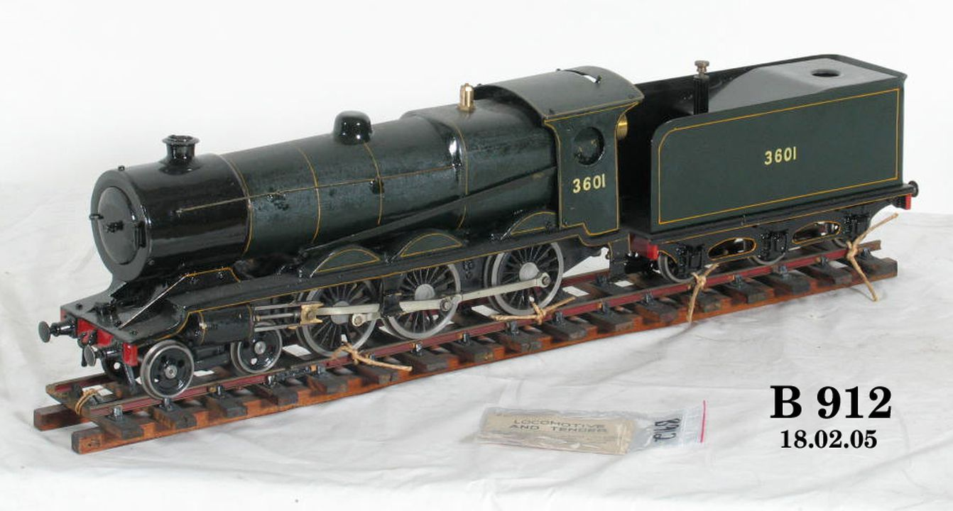 Steam locomotive model and tender on track, New South Wales