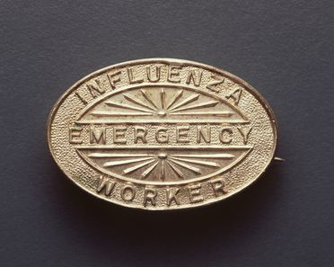 93/380/1 Badge, 'Influenza Emergency Worker', metal, made by Angus & Coote Ltd, Sydney, New South Wales, Australia, c. 1919