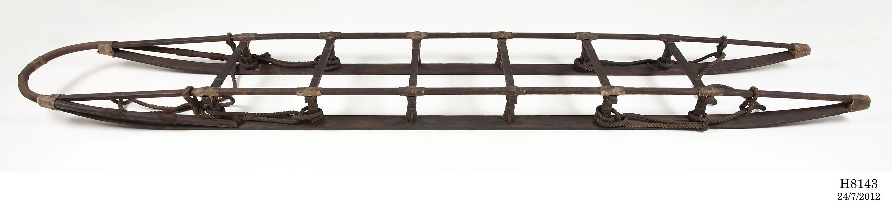 H8143 Sledge, full size, Corymbia maculata (spotted gum) / metal / natural fibre / leather, made by Alexander Worsfold, King Street, St Peters, New South Wales, Australia, 1911, used on the Australasian Antarctic Expedition led by Sir Douglas Mawson, Antarctica, 1911-1914. Click to enlarge.