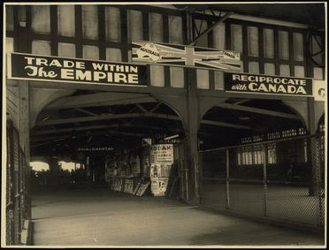 2002/105/1-2/47 Photographic print, black and white, billboard at Circular Quay Wharf promoting trade between Australia and Canada designed by Rousel Studios, Sydney, New South Wales, Australia, c 1930