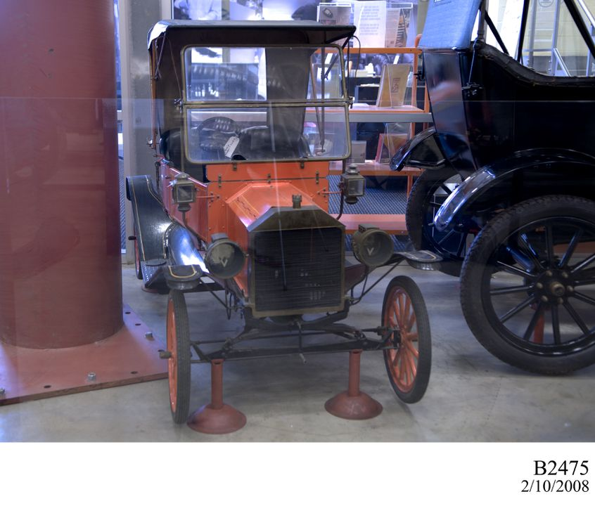 B2475 Automobile, half-scale, Ford Model T 1912, Runabout, two-door, single seat, wood/metal/vinyl/rubber, made by Richard (Bill) Gilbert, Eastlakes, NSW, Australia, c1970. Click to enlarge.