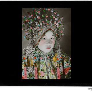 2010/75/1-71 Lantern slide (1 of 89), a woman wearing a headdress, glass / metal, Serge Vargassoff, Peking, China, 1920-1949