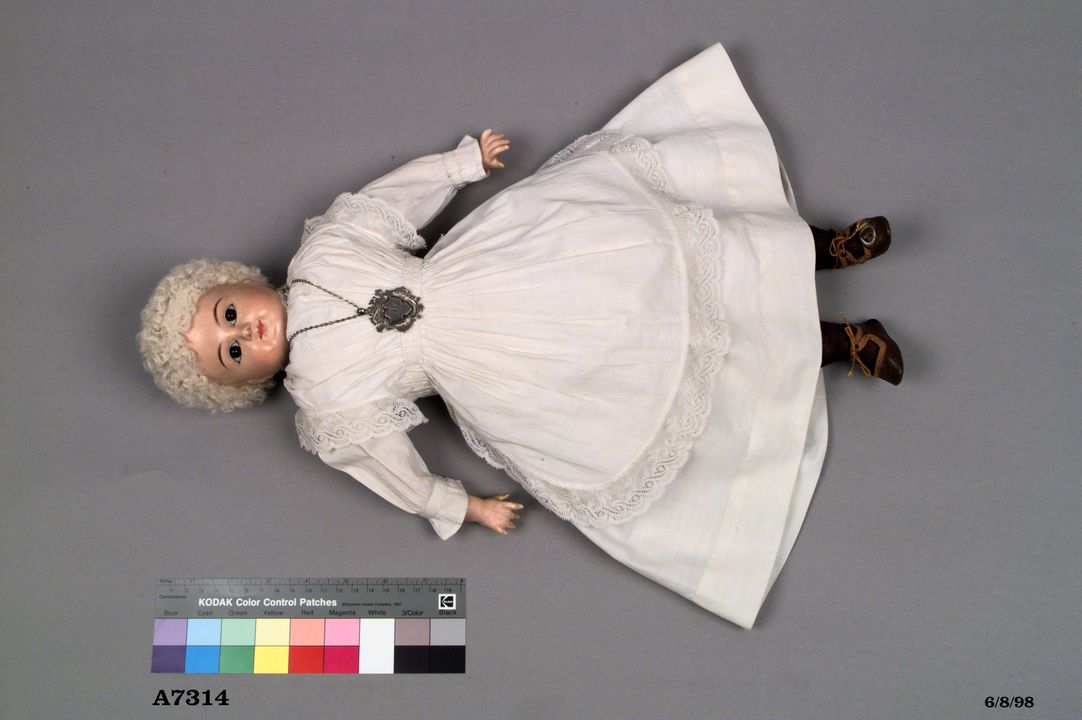 A7314 Composition doll, female and medal, made by Stephan Schilling, Germany, dressed by Florence Breaden, New South Wales, Australia, 1901. Click to enlarge.
