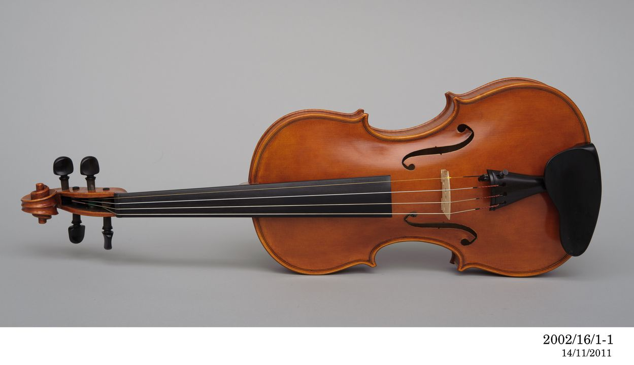2002/16/1 Violin with case and accessories, various materials, original design by Guarneri del Gesu, Italy, 1741, made by Harry Vatiliotis / Texas Instuments Inc, Concord / Dallas, Sydney, New South Wales / Texas, Australia / United States of America, 2001. Click to enlarge.