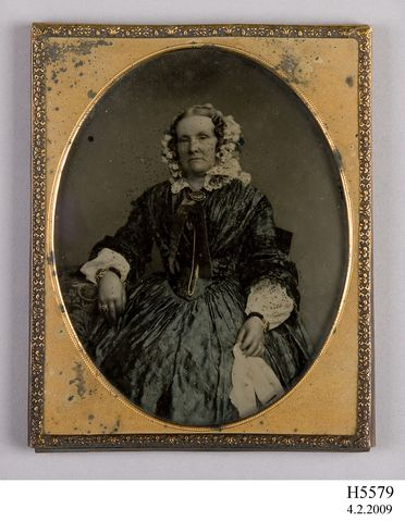 H5779 Photographic positive, ambrotype, hand-tinted, studio portrait of a woman, collodion / paint / glass / wood / paper / metal / velvet, photographed by Henry Death, Camberwell, London, England, 1860-1865