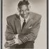 Image 1 of 2, 2012/27/4 Photographic print, publicity photograph of Nat 'King' Cole, paper / chipboard, photographer unknown, used by Lee Gordon and Max Moore, Australia, 1955. Click to enlarge