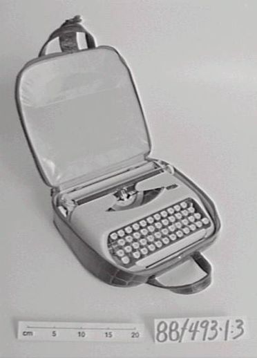 88/493 Typewriter and case, portable, 'Royal', aluminum / gold plate / rubber / leather, made by Royal Typewriter Co, United States of America, 1965-1968