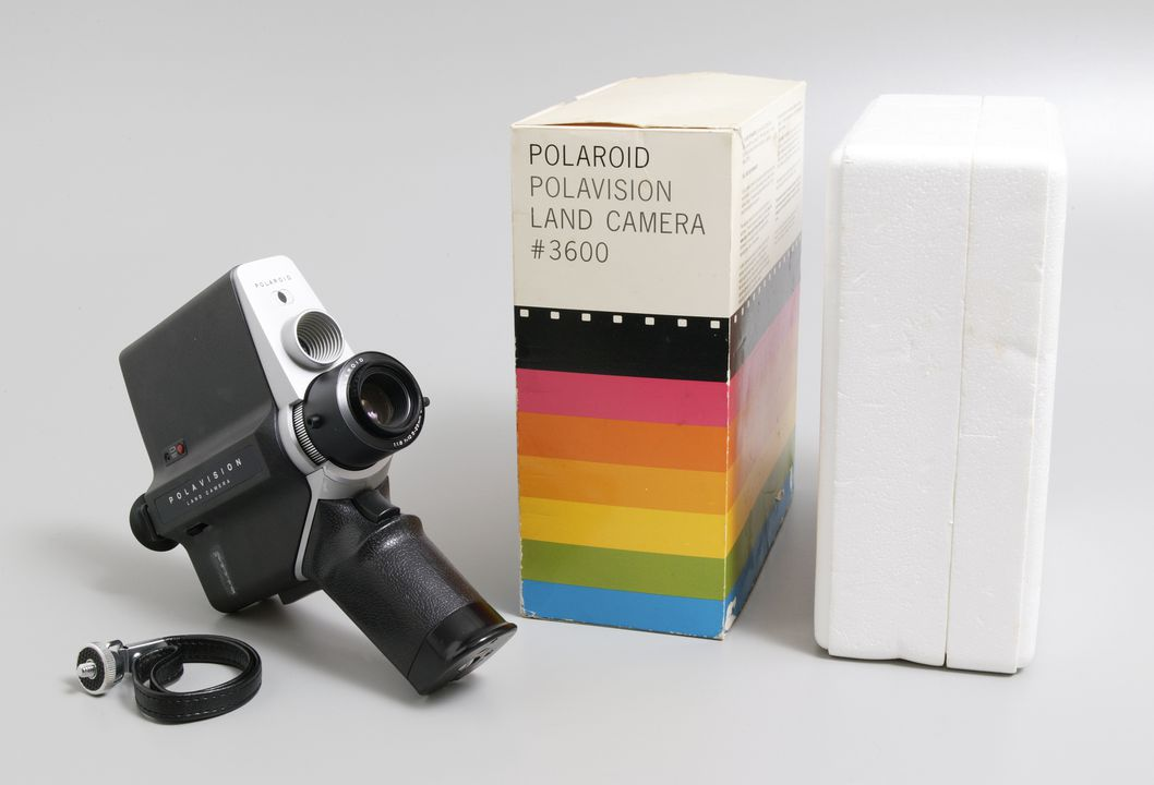 2003/29/1 Camera and accessories, Polavision Land camera with film and viewer, various materials, designed by the Polaroid Corporation, United States of America, manufactured by Eumig, Austria, 1978. Click to enlarge.