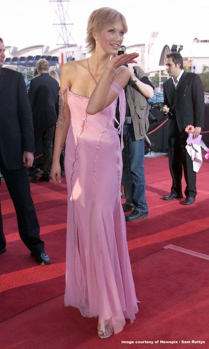 2005/1/1 Evening dress, beaded pink chiffon trimmed with charms, designed by Lisa Ho and made in the workrooms of Lisa Ho in Sydney, worn by Delta Goodrem to the ARIA Music Awards, Sydney, New South Wales, Australia, 2003. Click to enlarge.