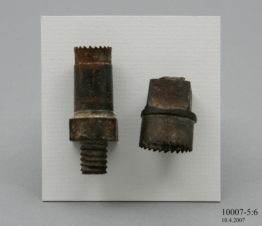 10007-6 Tubular saw for cutting button blanks from pearl shell, part of a didactic display, metal, maker unknown, Sydney, Australia, 1875-1885. Click to enlarge.