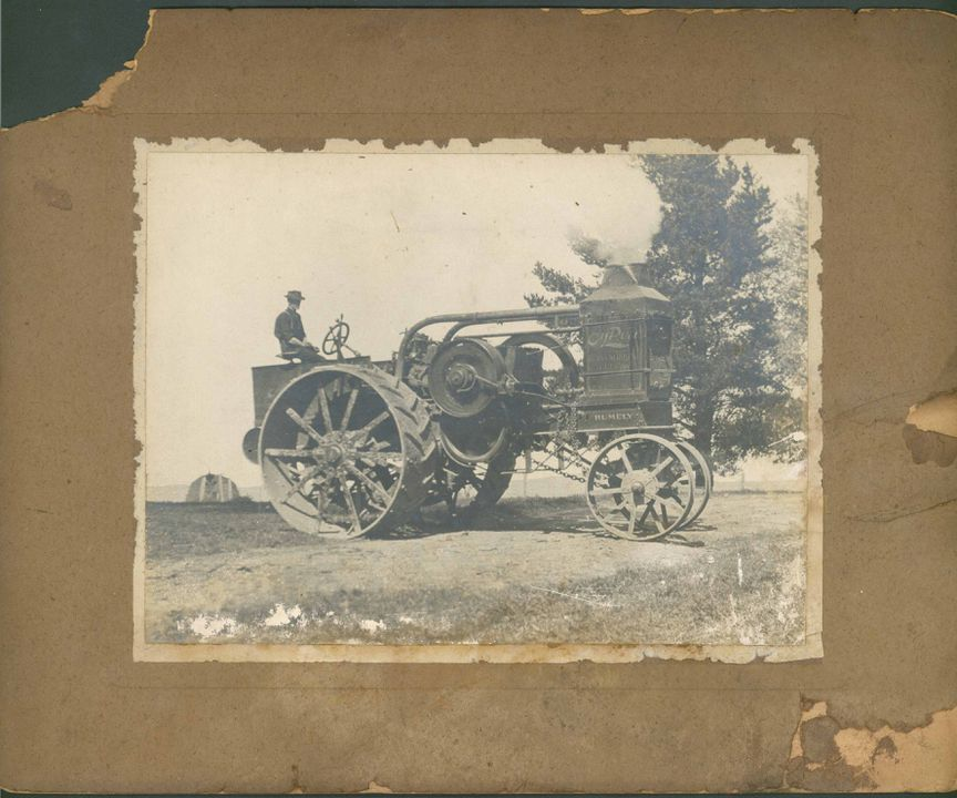 H8535-12 Photograph, depicting a Rumely 'Oil-Pull' kerosene tractor, built 1910-1918, mounted on a board, photograher unknown. Click to enlarge.