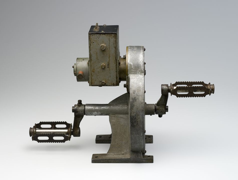 B2125 Pedal generator, brass / steel / paint, designed by Alfred Traeger, unknown maker, used by the Flying Doctor Service, Cloncurry area, Australia c 1930 - 1940. Click to enlarge.