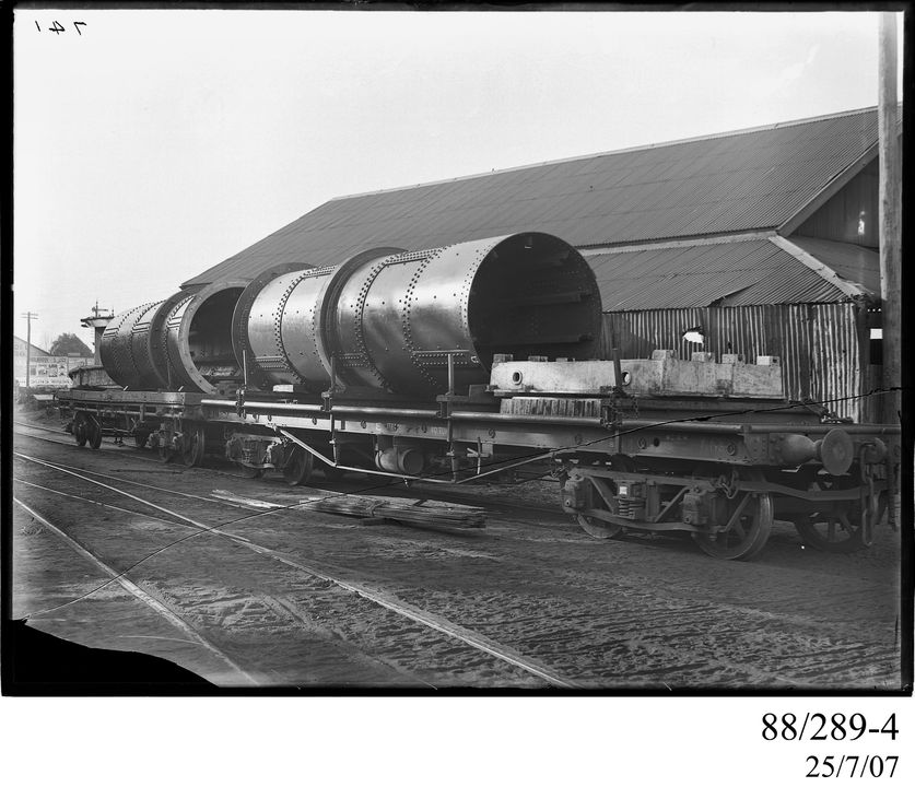 88/289-4 Photographic glass plate negative, depicting rotary cement kiln components built by Clyde Engineering Co. Ltd, Granville, New South Wales, Australia, for the Portland Cement Company, on board standard gauge railway bogie bolster wagons, 1900-1945. Click to enlarge.