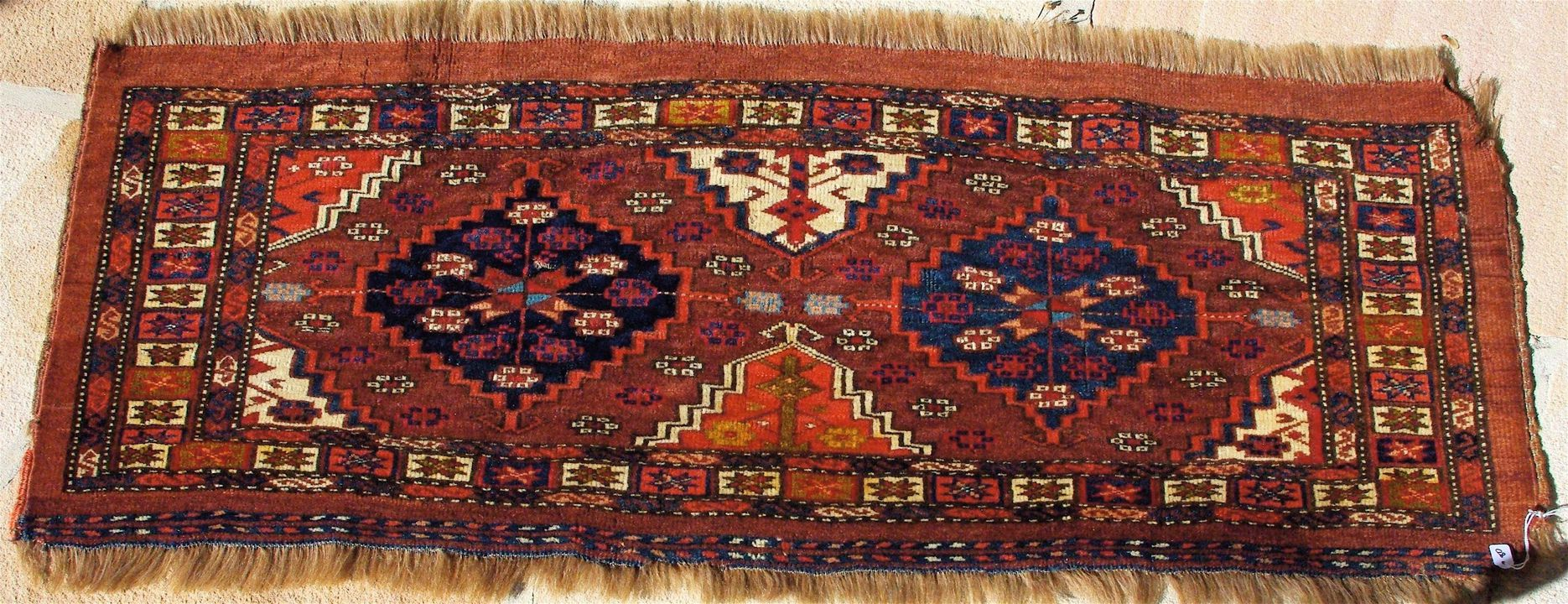 2015/26/50 Storage bag (torba) face, Chodor design, symmetrically knotted wool pile, probably made by Yomut Turkmen women, Turkmenistan, late 1800s. Click to enlarge.